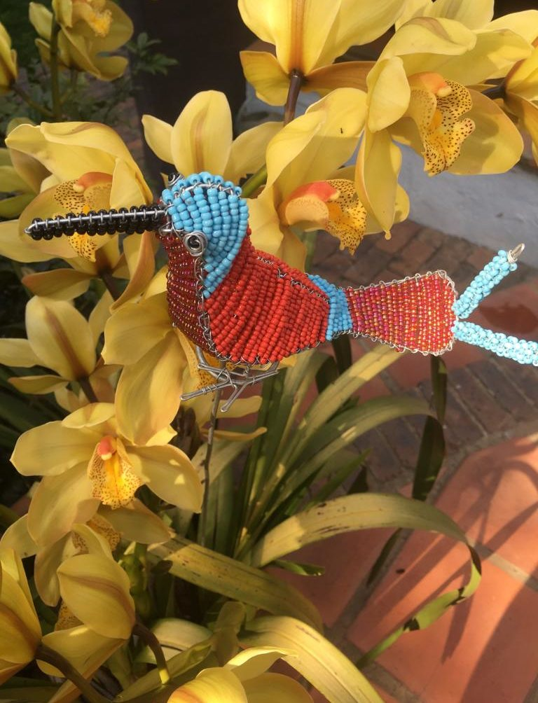 Beaded red and blue bird